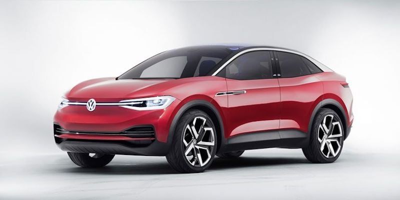 A red Volkswagen future vehicle against an all-white background.