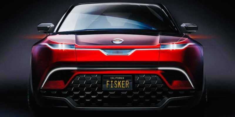 """The view of the front of a red future vehicle SUV, with a black grill, and a license plate that reads """"FISKER""""."""