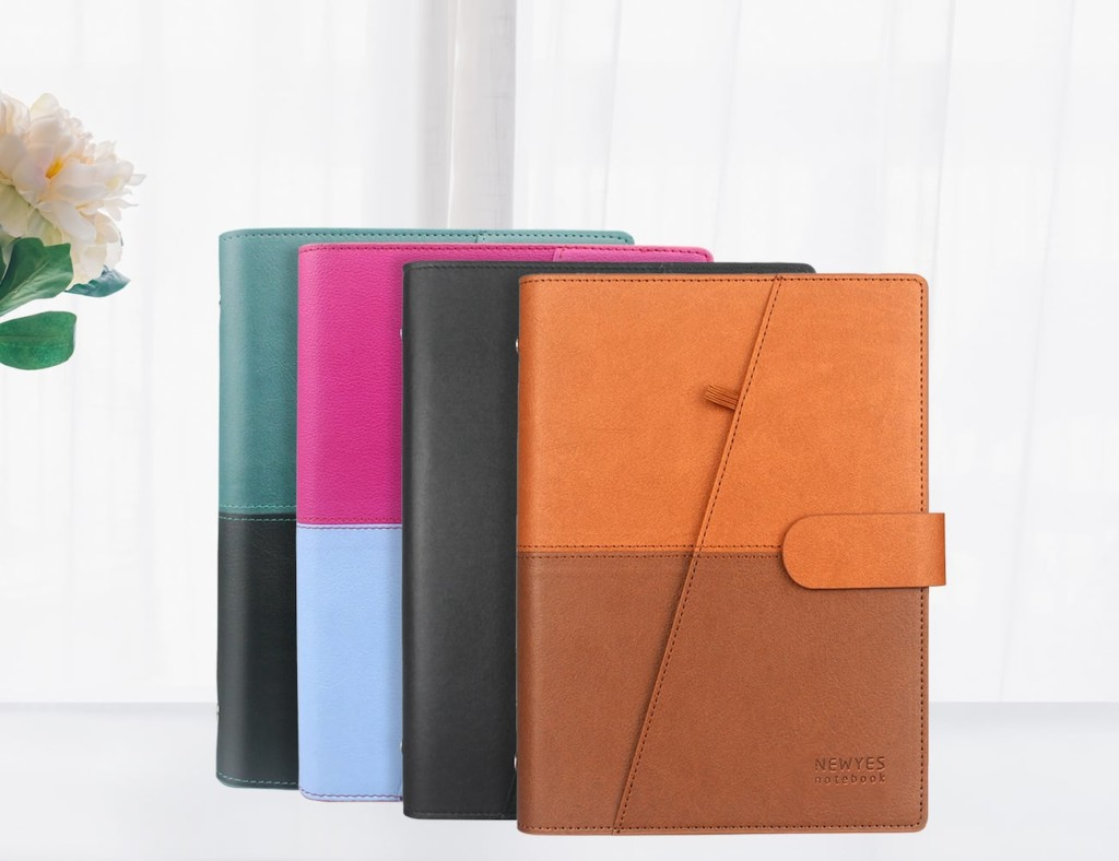 Four different color option of closed leather notebooks: dark tan and light tan, black, pink and light blue, green and black.