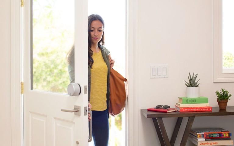 Person entering door with August Lock