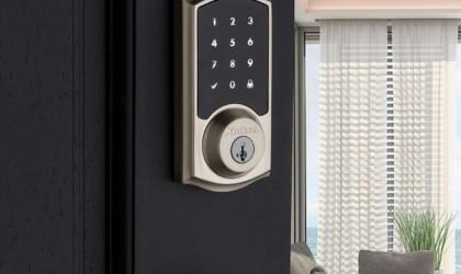 Kwikset lock on a black door