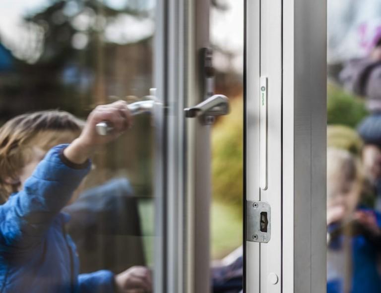 Child opening glass door