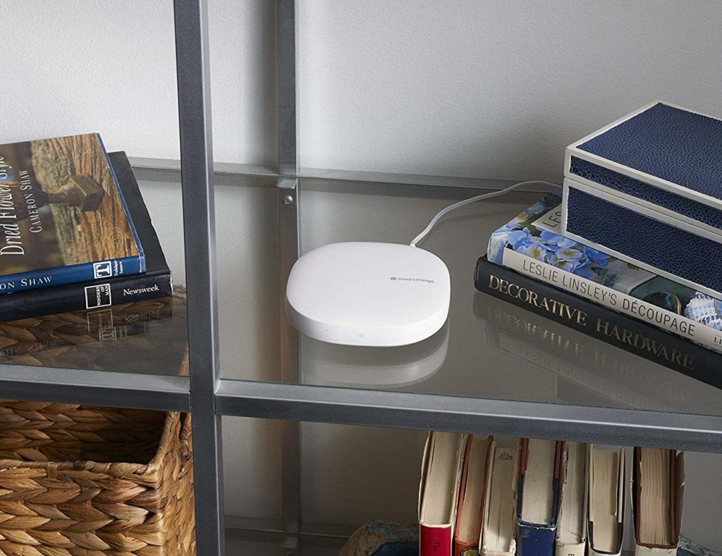 SmartThings hub on a glass table