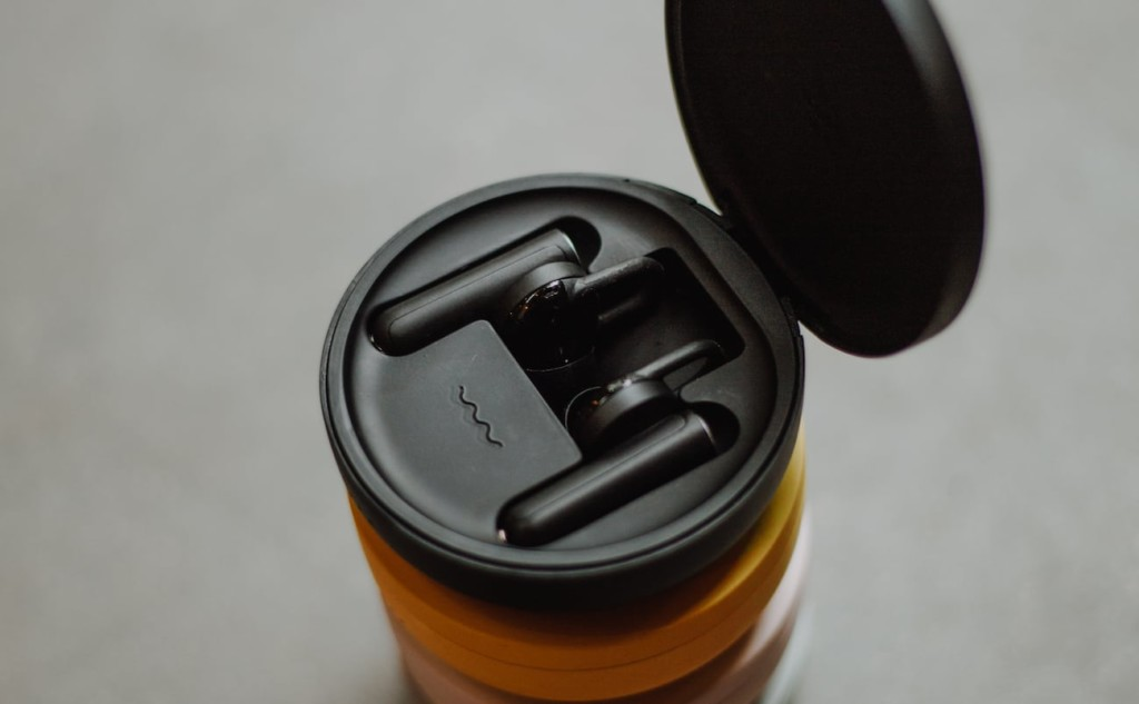 An open case of black comfortable earbuds.