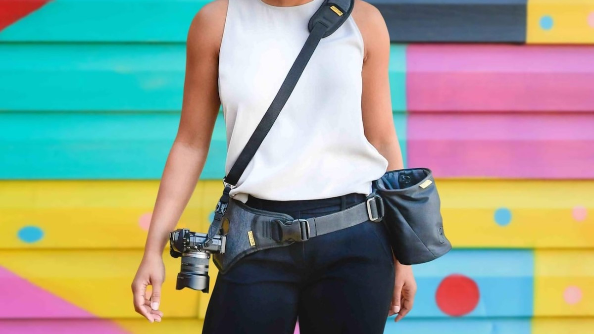 Cotton Carrier SlingBelt Gear Carrying System harnesses your camera with its ergonomic design