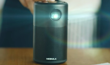 Person turning on Nebula projector