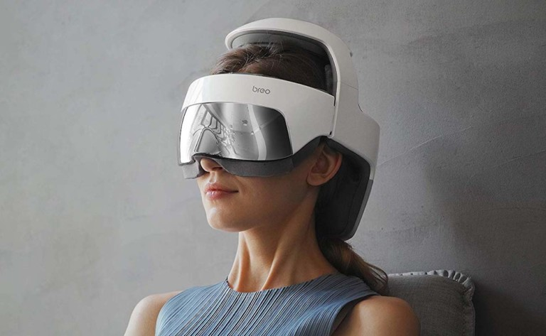 A woman is wearing a helmet that has a silver shield over her eyes.