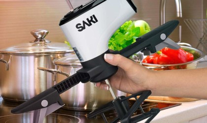 A hand is holding a self-stirring kitchen device.