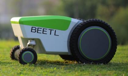 Beetl scooping poop