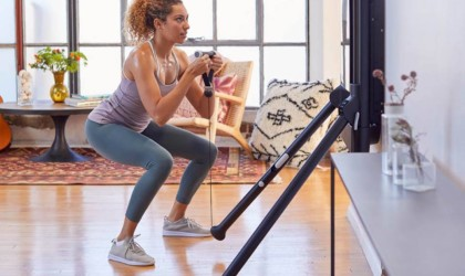 Person squatting before Tonal