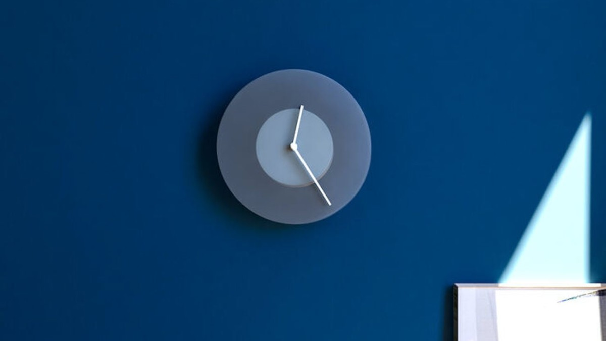 MoMA Dusk Shade-Changing Wall Clock slowly turns as the hours pass