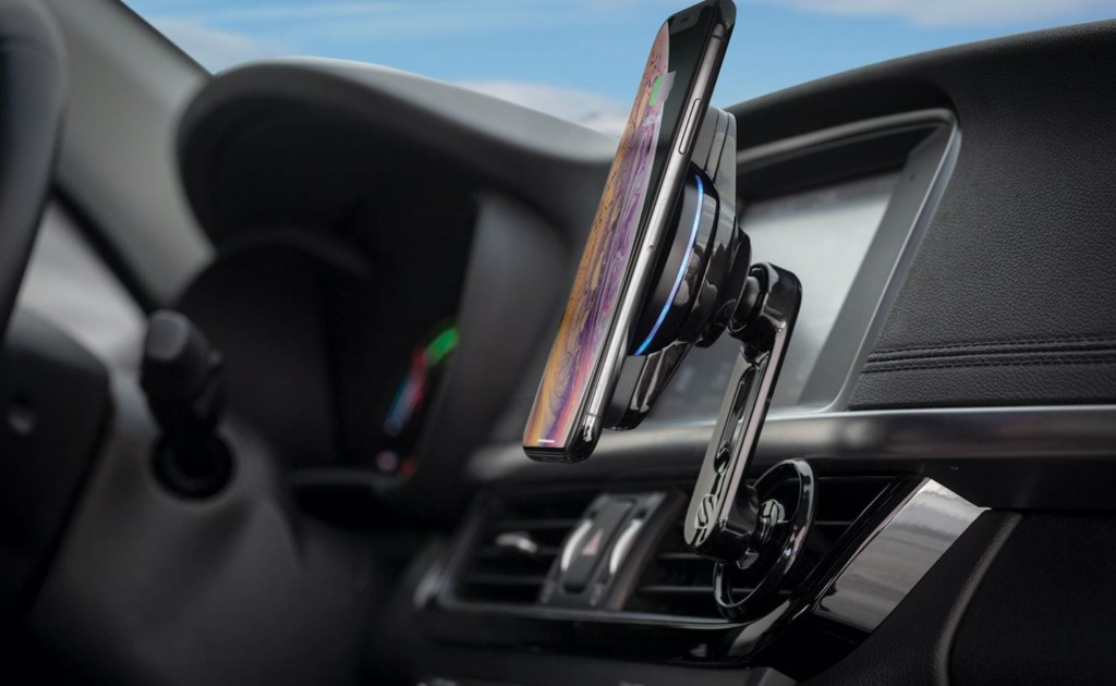 A close up view of a smart phone attached to a fast-charging car mount.