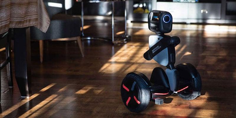 A black best robots robot in a kitchen.