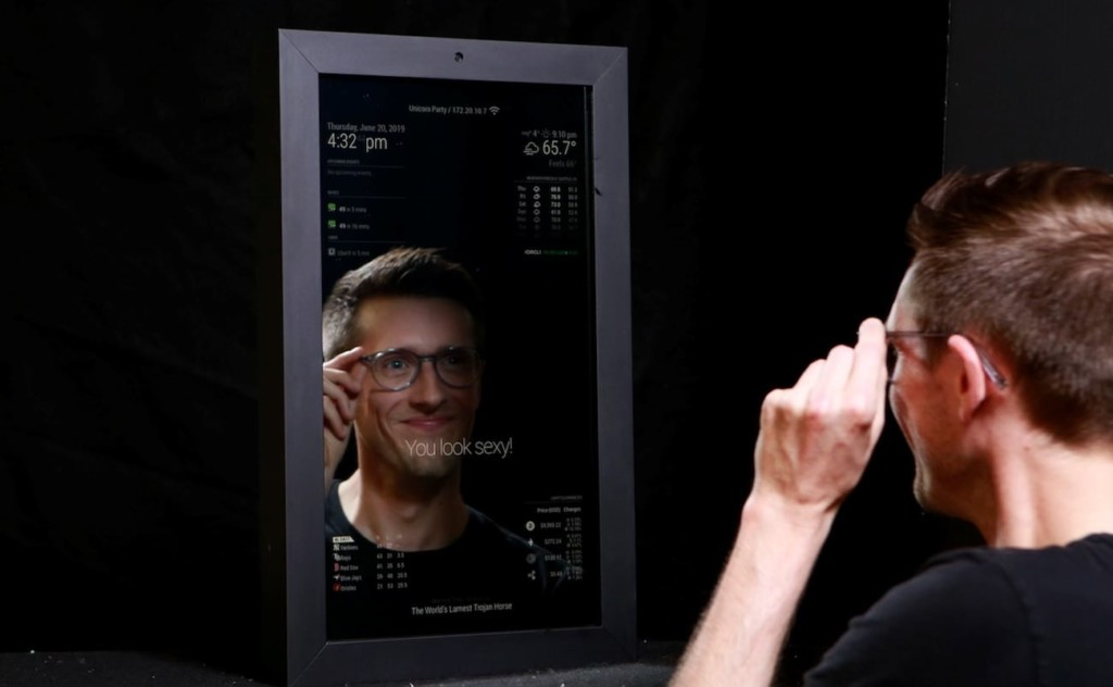 A man looking into a latest tech gadgets smart mirror.