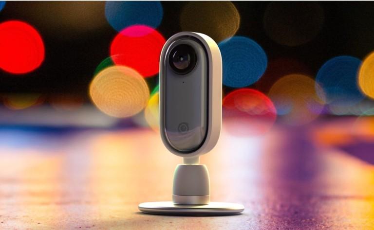 A small white latest tech gadgets video camera.