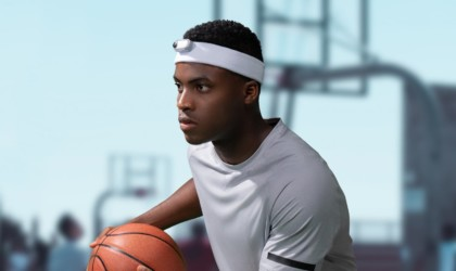 A basketball player wearing a headband with a latest tech gadgets video camera attached to it.