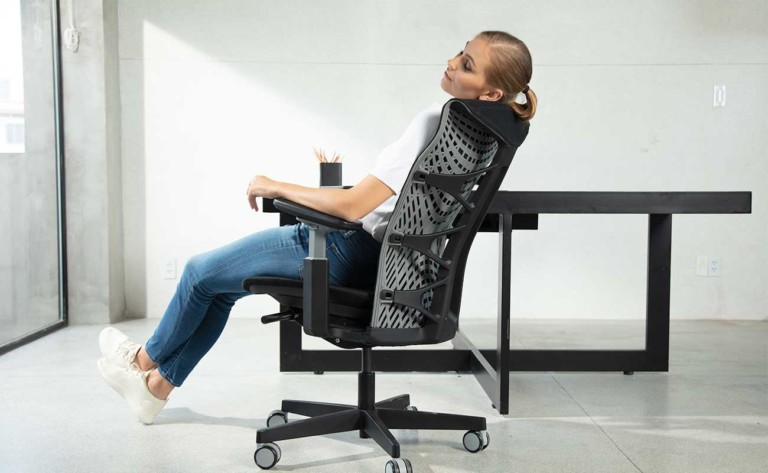 Person relaxing in Kinn Chair