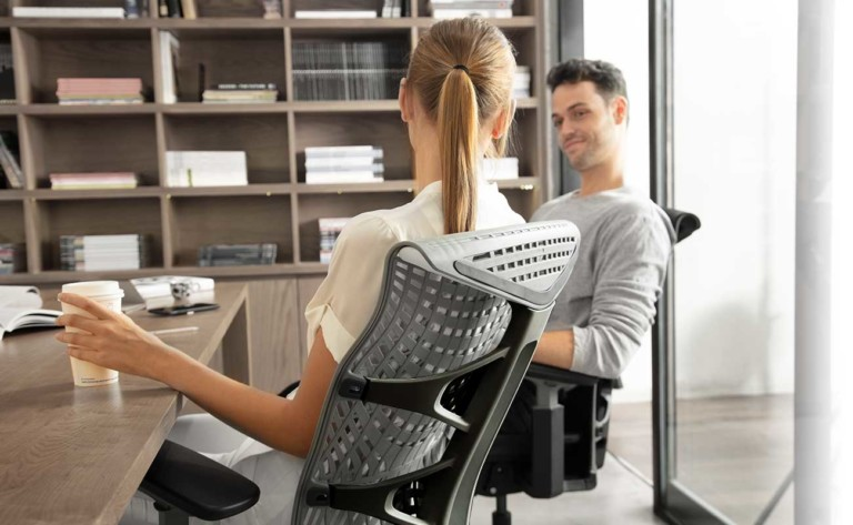 Two people in Kinn Chairs
