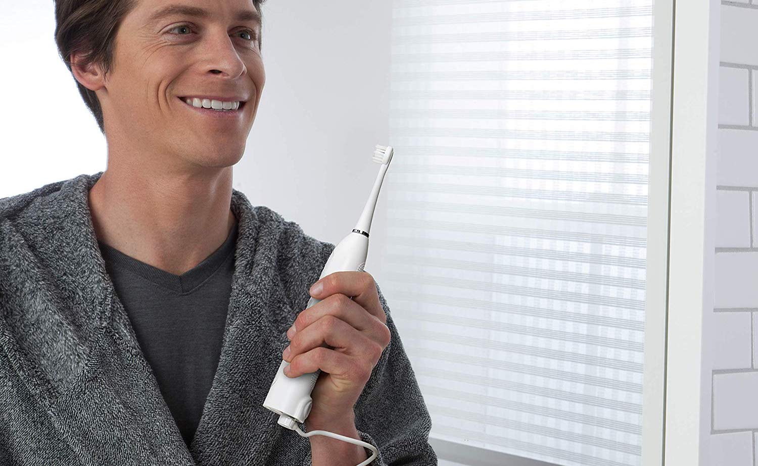 Waterpik Sonic-Fusion Flossing Toothbrush cleans your teeth's surfaces and between your teeth