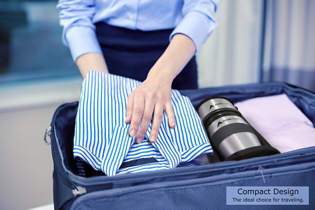 A woman is packing a suitcase and there is a compact coffee brewer in her suitcase.