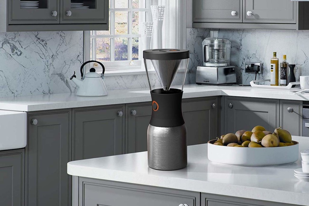 A compact coffee brewer for cold brew coffee is setting on a kitchen counter.