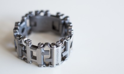 Leatherman tread bracelet on white background