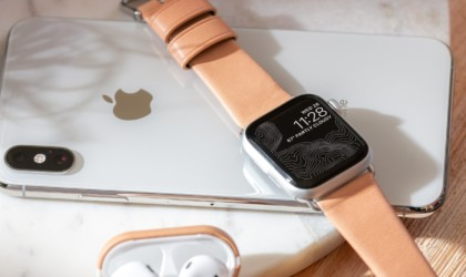 Apple watch, iphone, and airpods with leather accessories