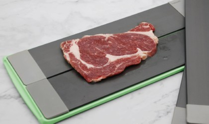 Close up of steak defrostingon tray