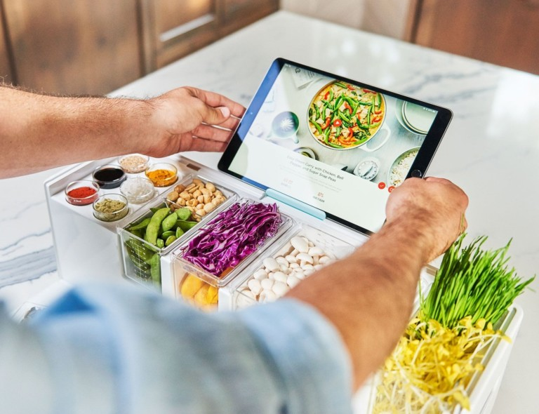 Person putting tablet on food prep station