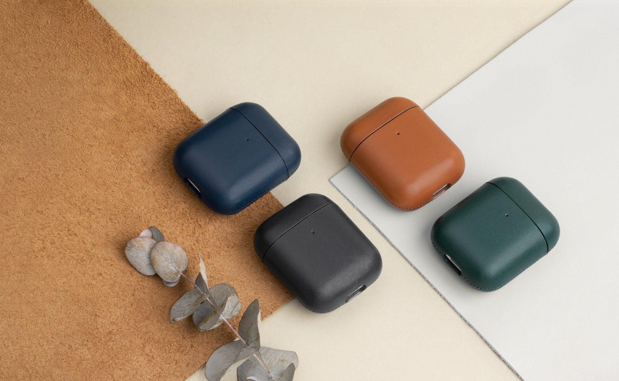 The fully wrapped leather airpods case is on a table.
