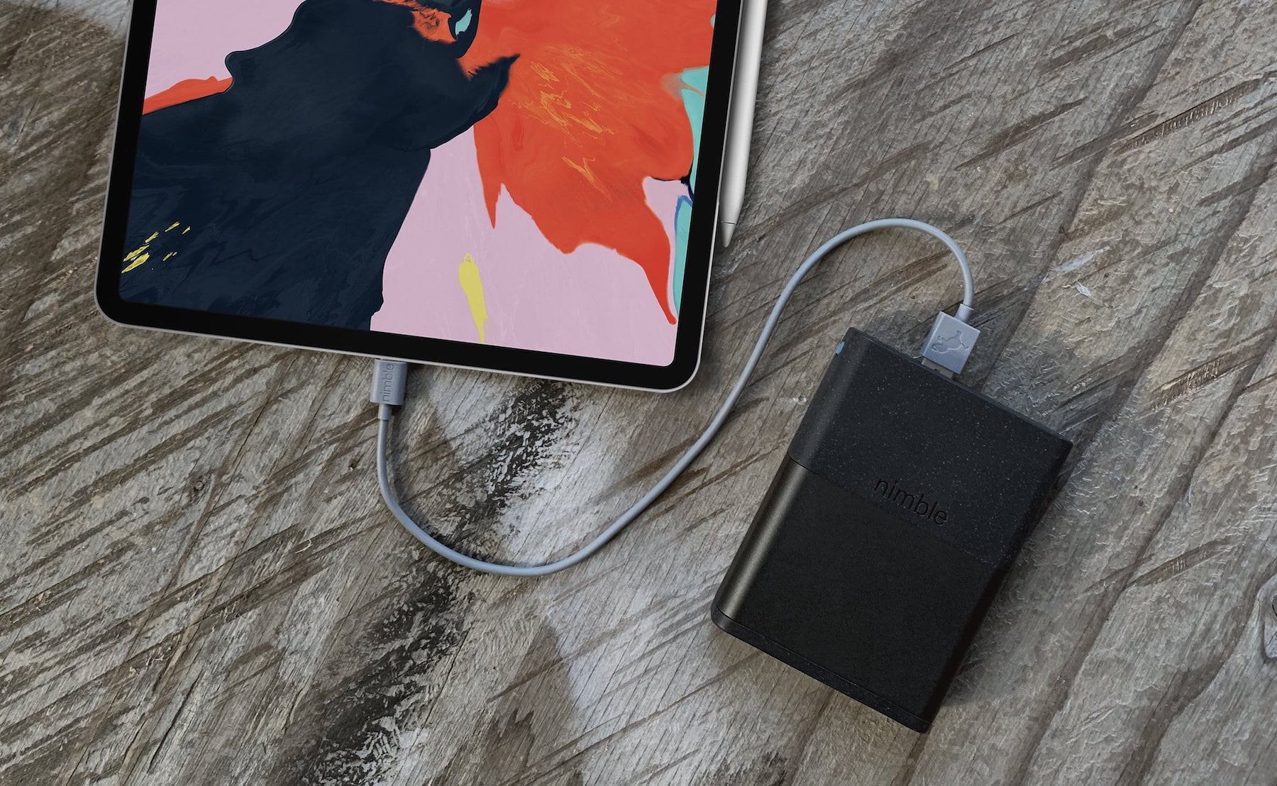The 5-day power bank is plugged into an iPad.