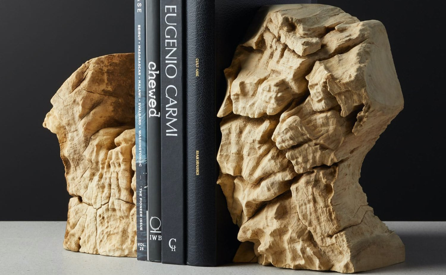 Reclaimed Teak Bookends by CB2 each have unique root characteristics