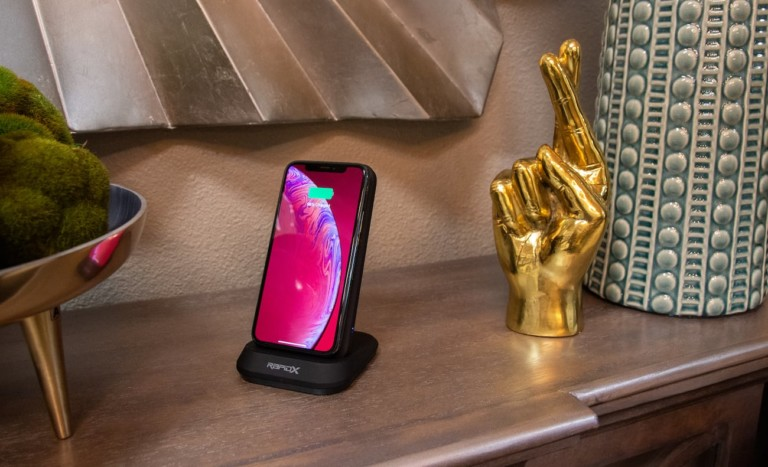 iPhone charging on wireless charging unit and stand