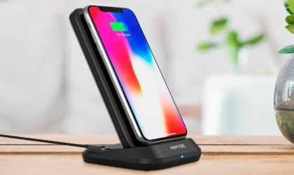 iPhone charging wirelessly on a stand