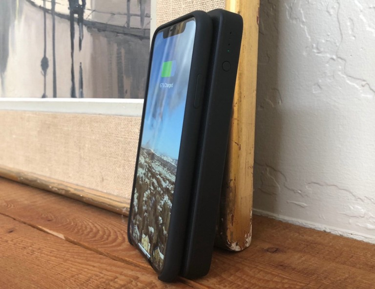 iPhone resting against portable power bank