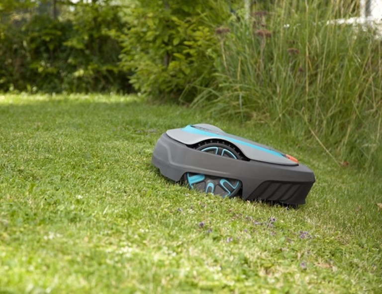 A robot lawnmower is mowing the lawn.
