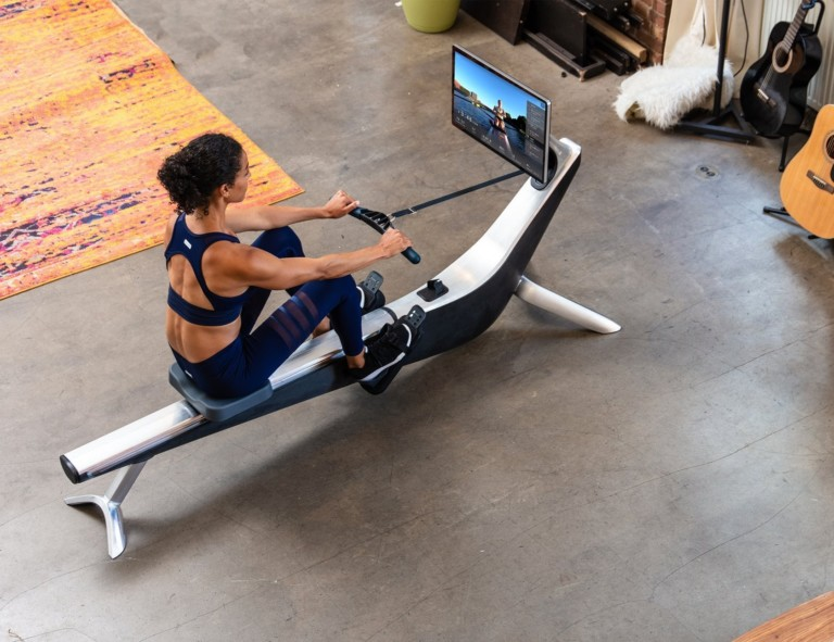 A top down view of a woman using a rowing machine.
