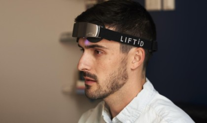 A side view of a man wearing a neurostimulation headband.