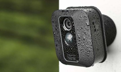 A small black camera is mounted outside, and there is condensation on the camera.
