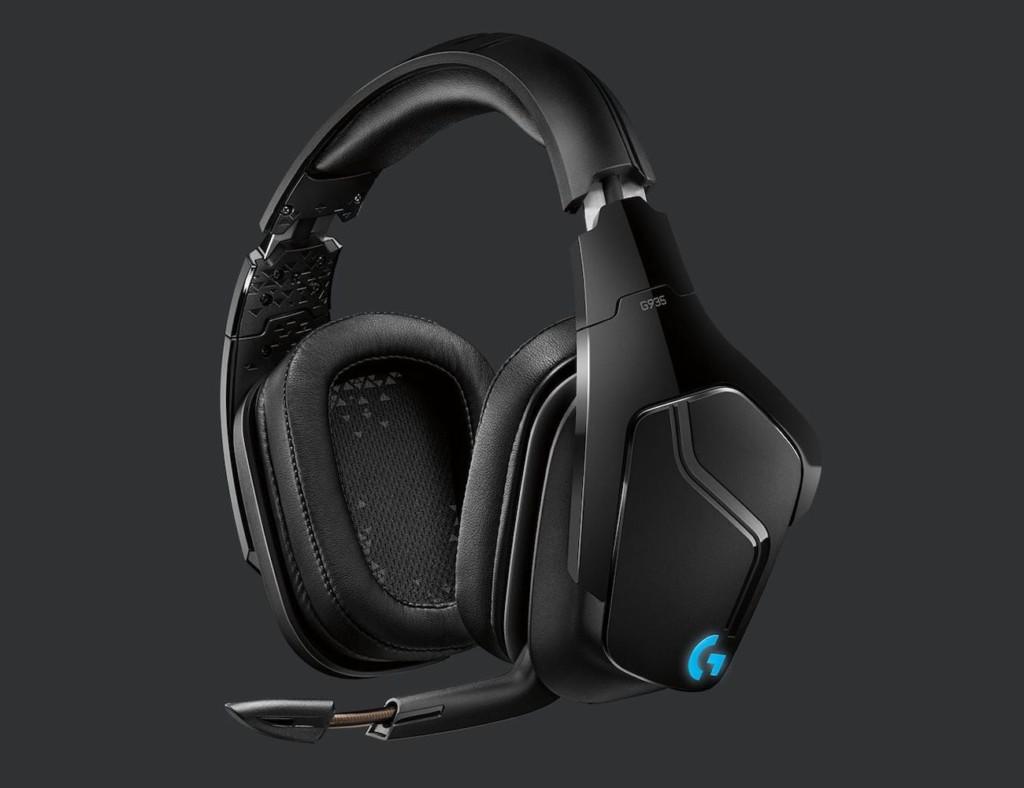 A pair of black headphones against a dark background.