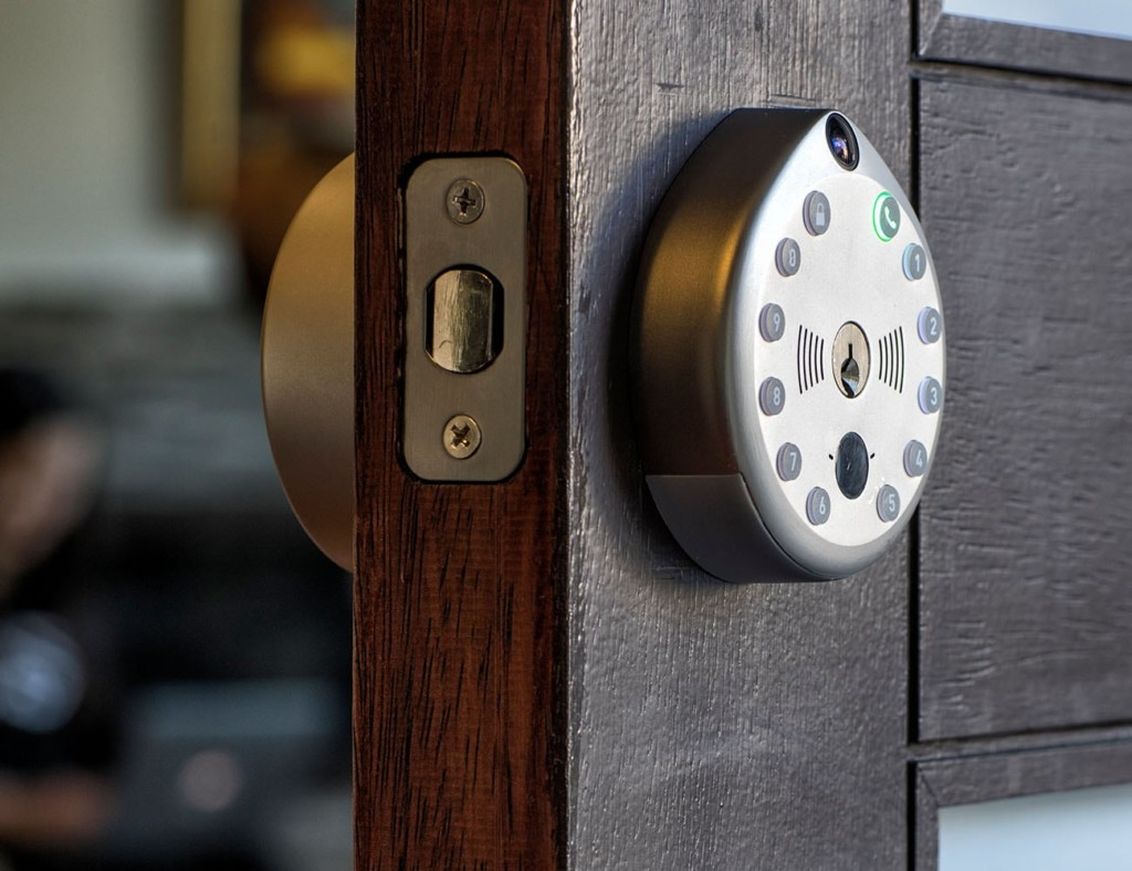 A dark wood door is open, and you can see both sides of the keyless door lock on it.