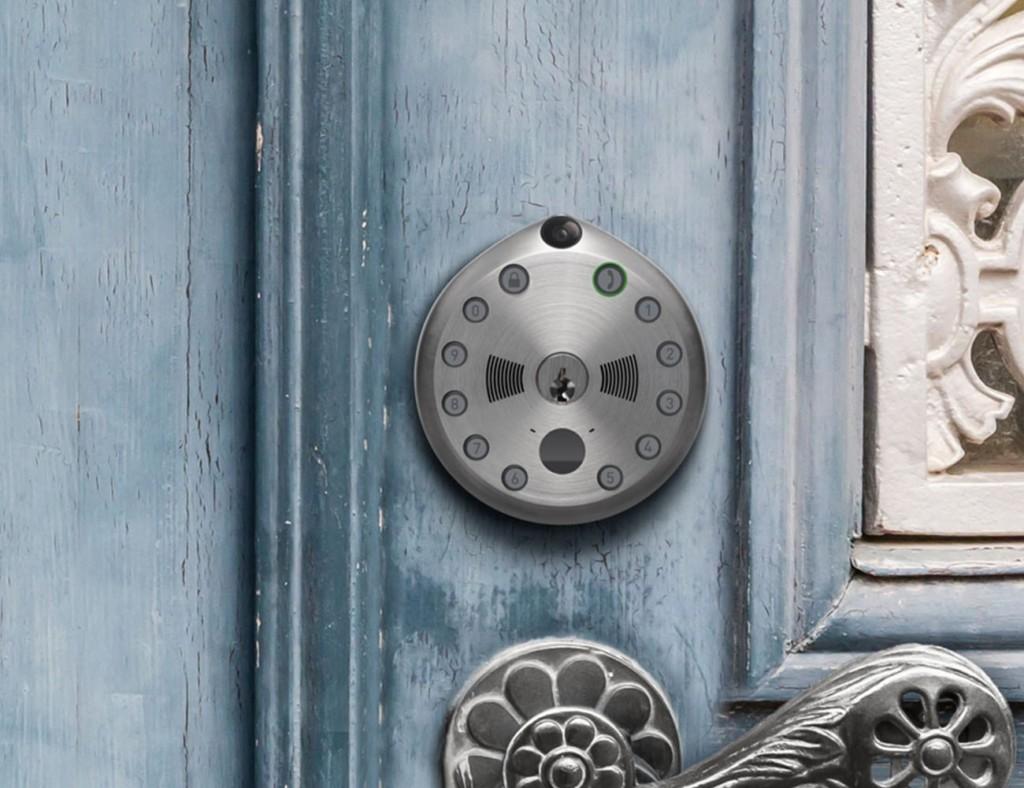 A round keyless door lock is on a blue door.