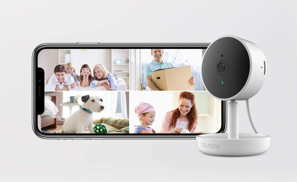 A home security cam is against a light gray background next to a smartphone with camera feed images on it.