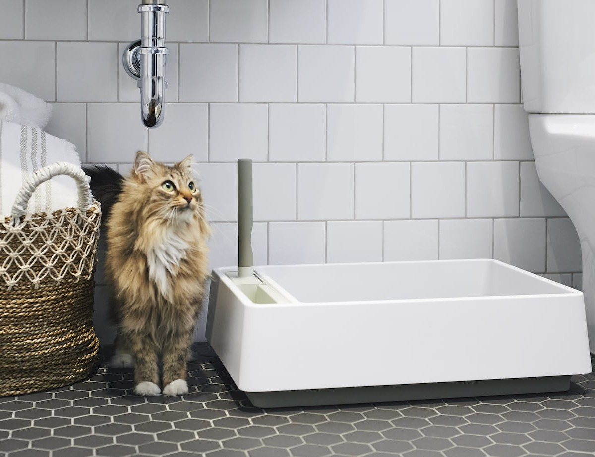 Tuft & Paw Cove All-in-One Recycled Litter Box beautifully stores all your cat litter necessities