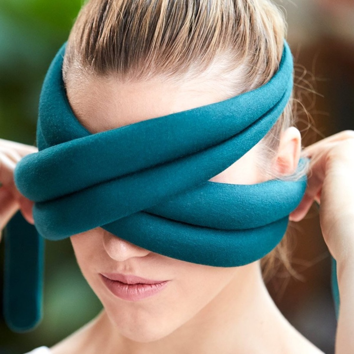 OSTRICHPILLOW LOOP Eye Mask Pillow wraps around your face to black out the world