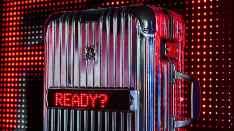 RIMOWA & Moncler Reflection Mirrored Aluminum Suitcase lets you customize its LED ticker screen