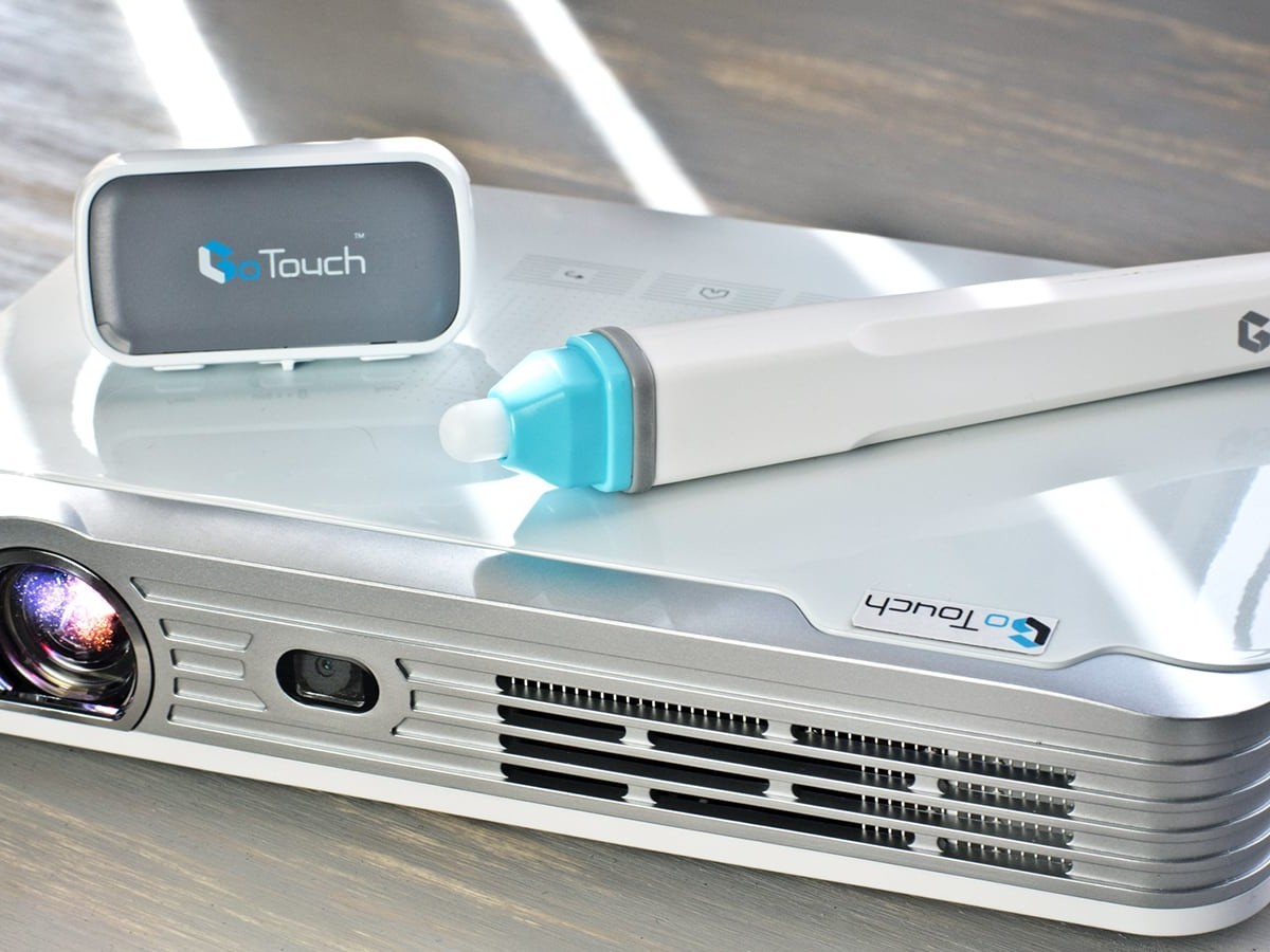 GoTouch Beam Whiteboard Projector lets you write and draw on any surface