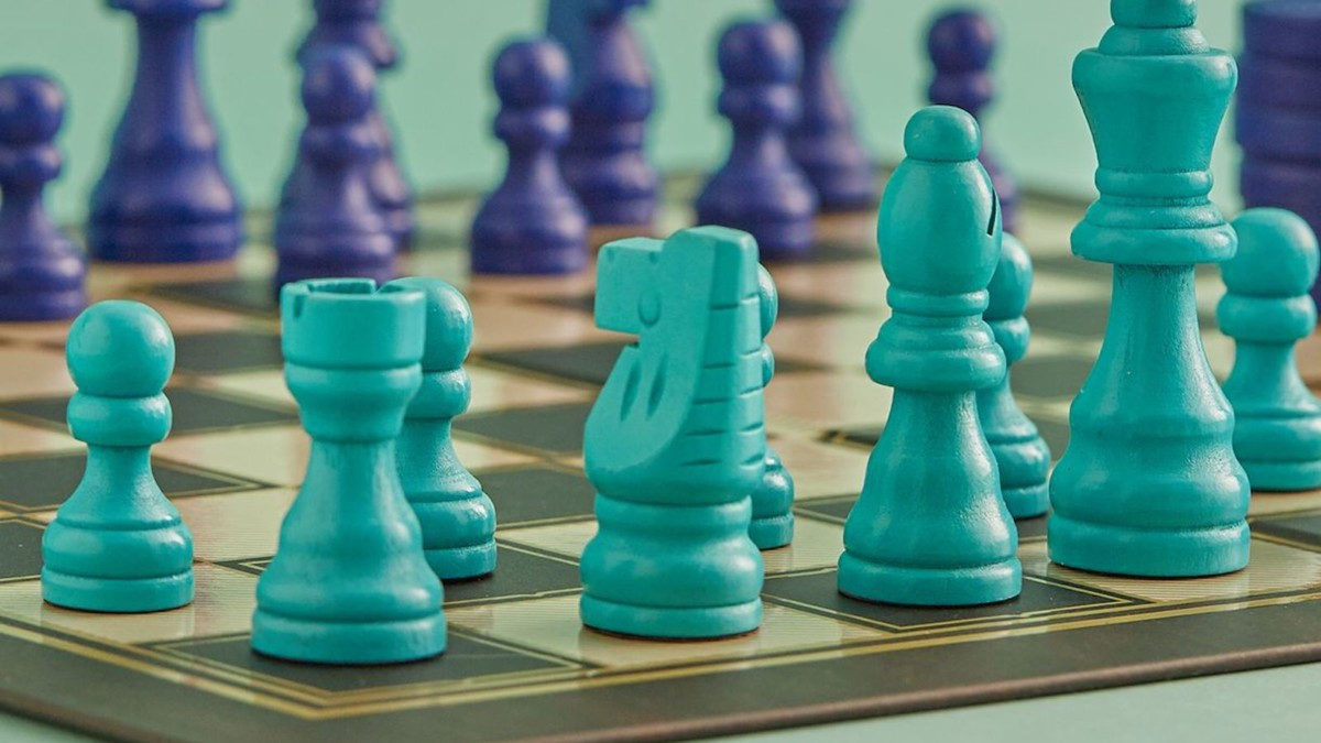 Ridley's Games Room Chess & Checkers Game Set has a fun, bright blue color scheme