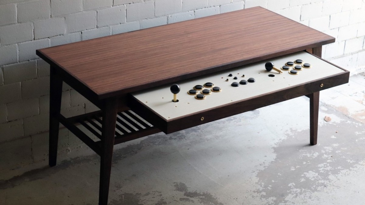 Love Hulten Coffee Table Retro Gamer Desk has a pull-out drawer with two full arcade stick set-ups