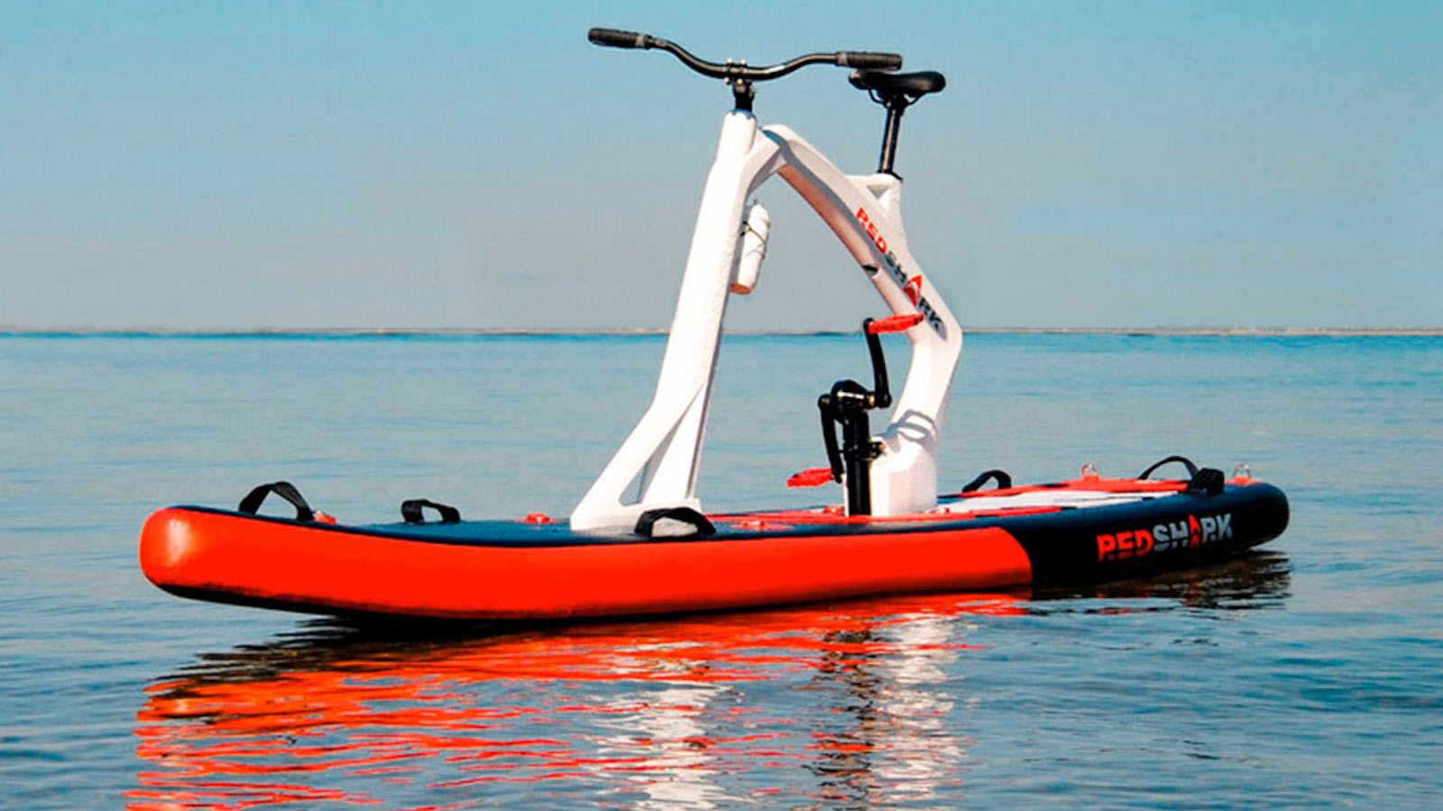 Red Shark Bikes Enjoy Inflatable Stand-up Paddleboard comes with pedals for movement